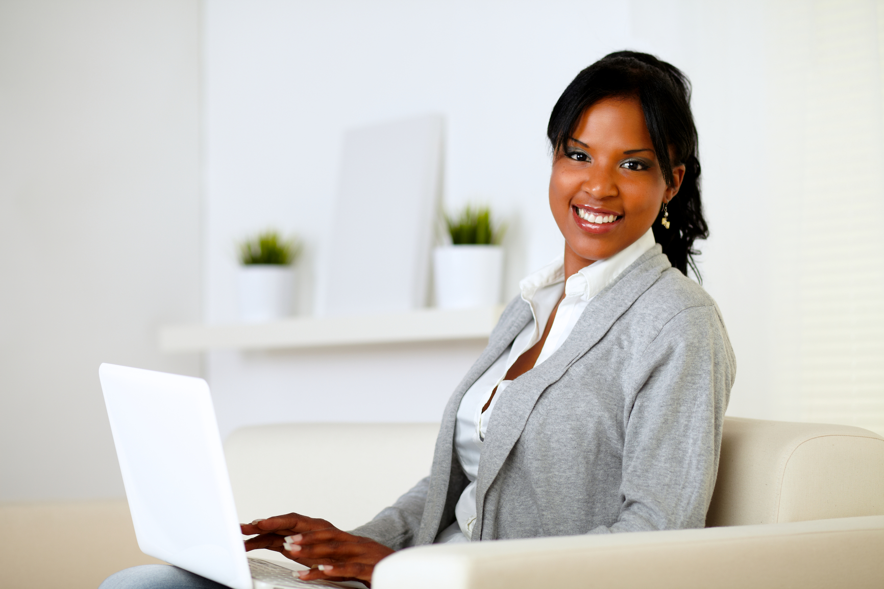 Happy woman browse the Internet on laptop